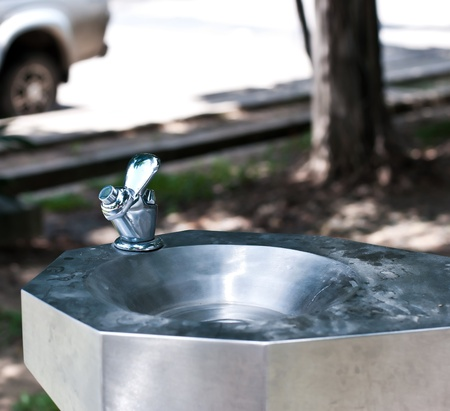 Closeup of public water fountain in park. Stock Photo
