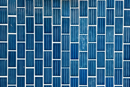 Tile texture background of bathroom or swimming pool tiles on wall. photo