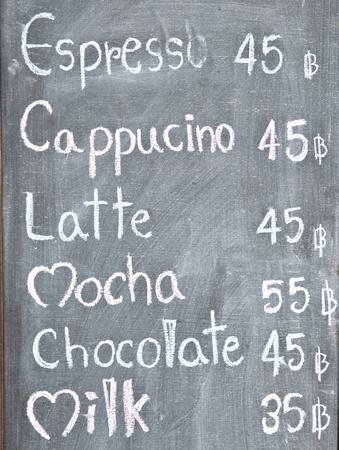 Menu in front of coffee shop, chalk on blackboard. photo