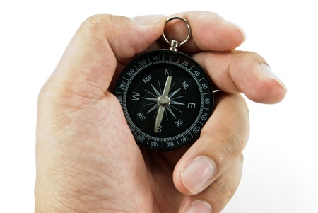 Hand holding a compass Stock Photo - 11081067
