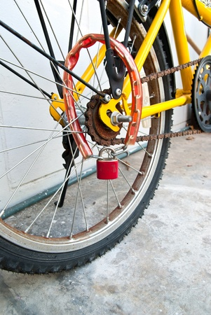 Security lock blocking the bicycle wheel  photo