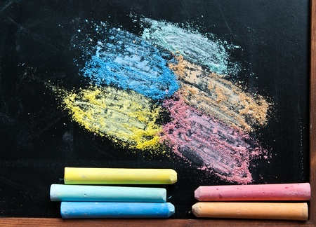 Chalk dust on blackboard photo
