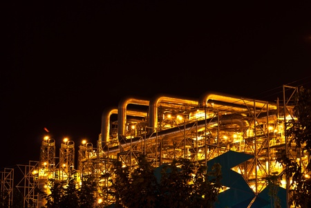 Petrochemical oil refinery plant at night photo