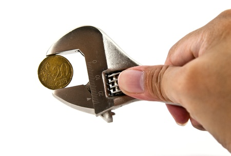 Hand holding a wrench with Euro coin  photo