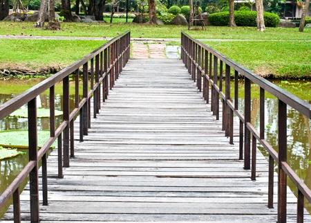 Wooden bridge across a pond  photo