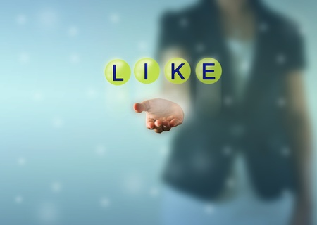 Business woman hand and LIKE words show in green crystal ball photo