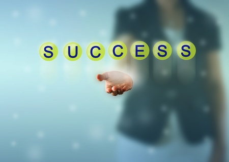 Business woman hand and SUCCESS words show in green crystal ball photo
