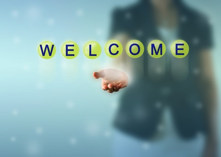 Business woman hand and WELCOME words show in green crystal ball photo