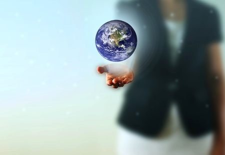 Earth globe in the Business woman hand. Photo earth from NASA satellite.  photo