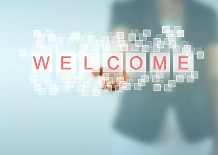 bienvenida: Empresas mano de la mujer y palabras de bienvenida Foto de archivo