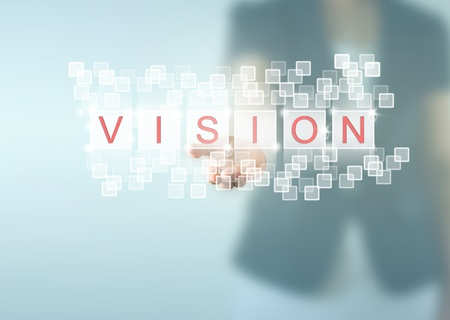 Business woman hand and VISION words