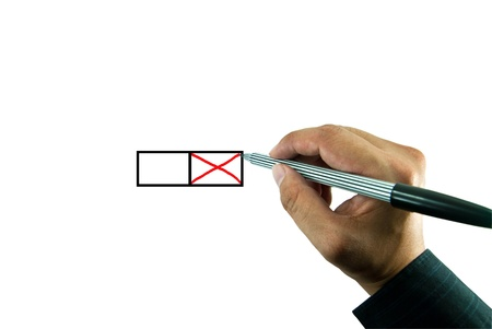 Businessman hand marking x on the check box photo