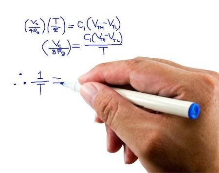 Teacher hand writing a mathematical equation on a white screen. photo