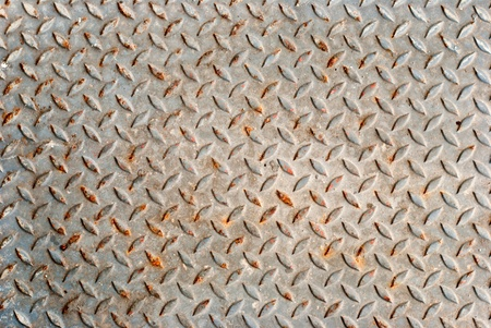 grudge: Grudge and rusted diamond metal background Stock Photo