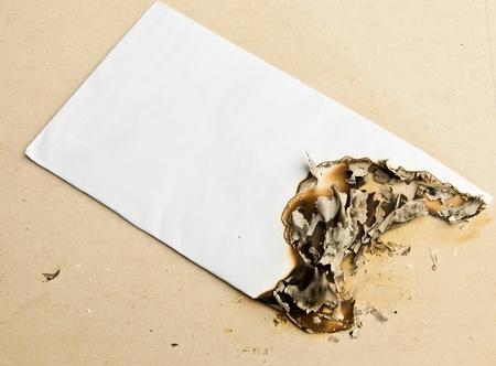 Burned white envelope