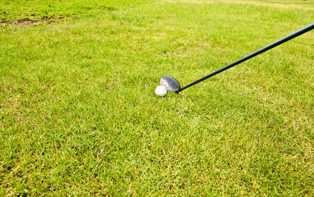 Golf ball and golf club sitting in green grass Stock Photo - 13277214