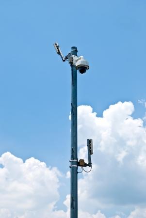 Dome CCTV camera against the blue sky  photo