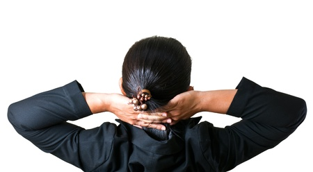 Close up of relaxed business woman from behind with open hands behind her head