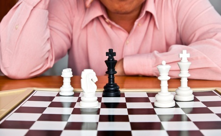 Man thinking about chess strategy  photo