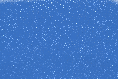 Water drops on blue background photo