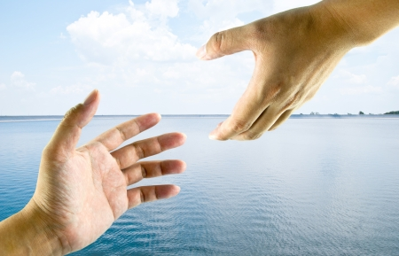 A hand help from another hand. This image ideas for a rescue, safety, religious or support concept.