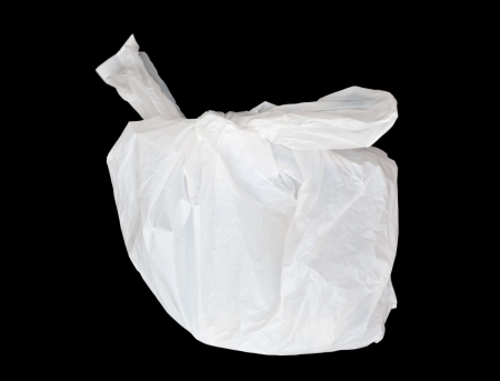 Plastic bag isolated on black  photo