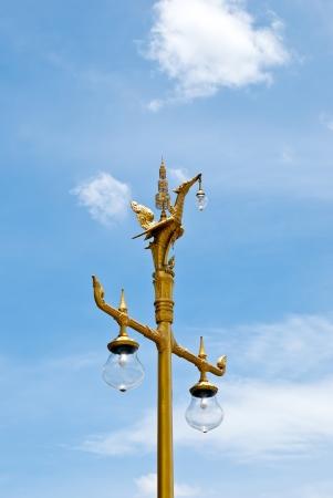 Golden swan, Thai style light pillar lantern with blue sky photo
