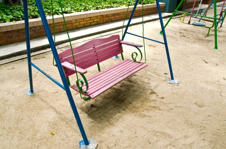 Wooden garden swing photo