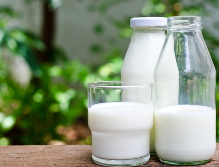 Bottle of fresh milk and glass on a wooden table Stock Photo