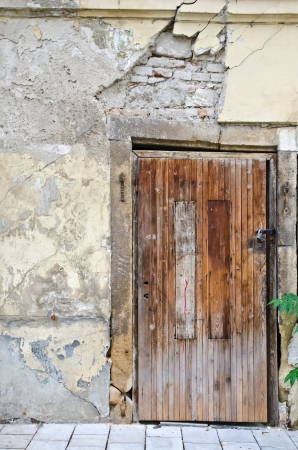 Old wooden door on grunge wall  photo