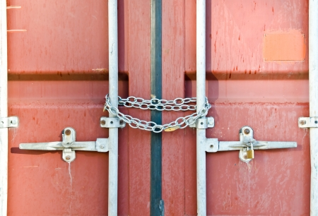 seafreight: Red container locked by chain