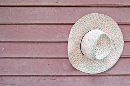Old hat on a wooden wall  photo