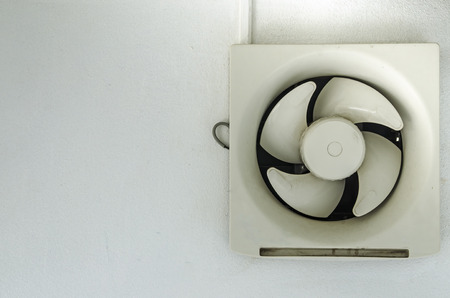 extractor: Extractor fan on a wall