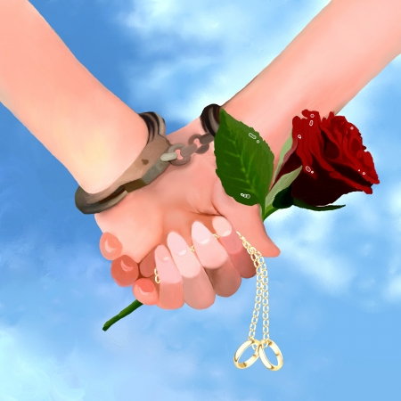 Proposal of marriage  Man and woman Holding Hands in handcuffs together with Engagement Ring and A Beautiful Red Rose photo