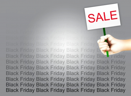 Person Holding A Placard with Text SALE on Black Friday Background, Sign for Start Christmas Shopping Season Stock Photo - 16010932