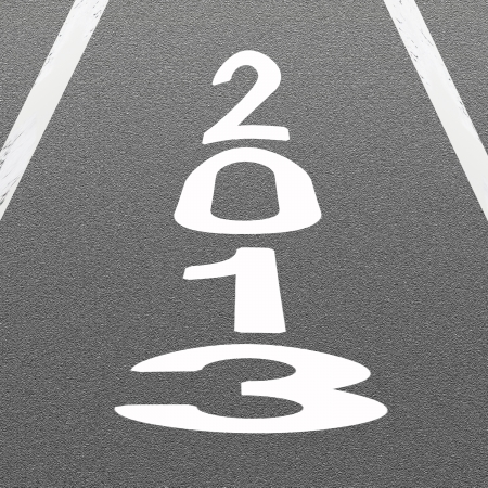 The Signal White Arrow and Word 2013 Painted On A Road Surface Freshly Covered with Asphalt Concrete Texture  photo