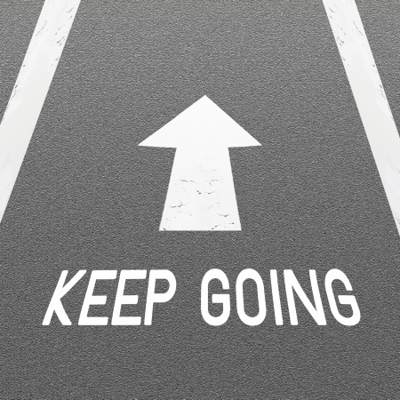 The Signal White Arrow and Word  Keep Going  Painted On A Road Surface Freshly Covered with Asphalt Concrete Texture photo