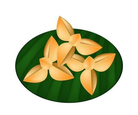 bułka maślana: Przekąskowy i deser, tajskie Kruche ciasteczka w kształcie Melodorum fruticosum Lour lub kwiatu ylang-ylang na Banana Leaf. Ilustracja