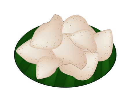 Thai Snack, A Stack of Thai Rice Crackers or Crisp Rice  Made From Flour, Salt and Sugar on Green Banana Leaf.