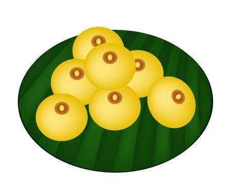 очаровательный: Традиционный тайский десерт, Иллюстрация Очаровательная Луны или рисовой муки и клейкого муки Вареники с яичными желтками на Green Banana Leaf.