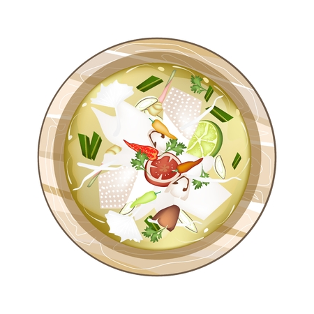 popular soup: Thai Cuisine, Chicken Tom Yum or Traditional Thai Spicy and Sour Soup with Chickens, Mushroom, Coconut Milk and Herbs. One of The Most Popular Dish in Thailand.