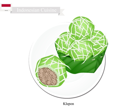 sweetmeat: Indonesian Cuisine, Klepon or Traditional Pandanus Rice Balls Made From Glutinous Flour and Grated Coconut with Caramelized Coconut Filling. One of The Most Popular Dessert in Indonesia.