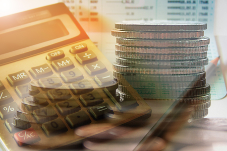 Double exposure of coins with calculator and book bank account for finance concept Stock Photo