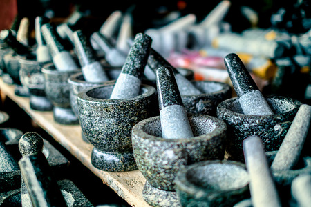 Selective focus of granite stone mortar and pestle, the famous Thai kitchenware product at Ang Sila, Chonburi, Thailand
