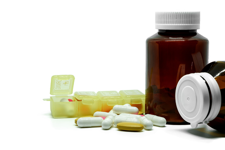 Medicine pills, vitamins, bottles and box on white background with copy space, Healthcare and medical concept