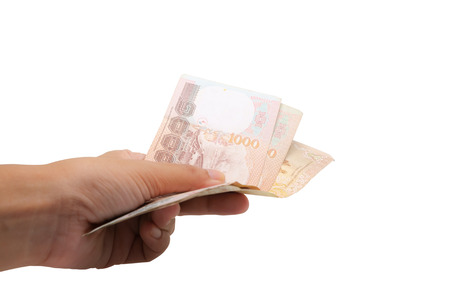 Hand holding Thai currency, 1000 Baht, money banknote of Thailand isolated on white background, business and finance concept