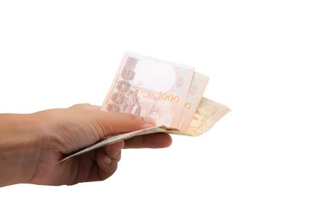Mano que sostiene la moneda tailandesa, 1000 Baht, billete de banco del dinero de Tailandia aislado en el concepto blanco del fondo, del negocio y de las finanzas Foto de archivo - 90617353