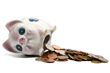 Piggy bank with coins on white background for saving money concept