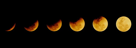 The moon after total eclipse ends in the different time on the dark night background in Chonburi, Thailand on January 31, 2018