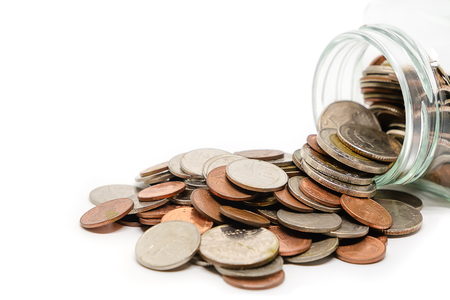 Coins in glass jar and outside, Thai currency money on white background for business and finance concept